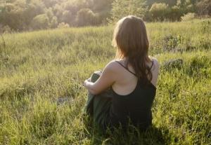 Abused teenager in field